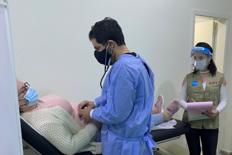 A doctor examining a patient