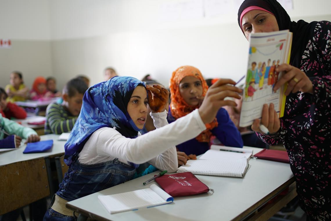 Girl participating in class.