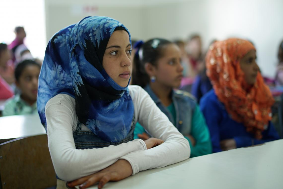 Girl in blue veil sitting in class