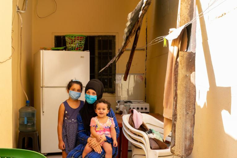 A mother and her children in their house at al Karantina area