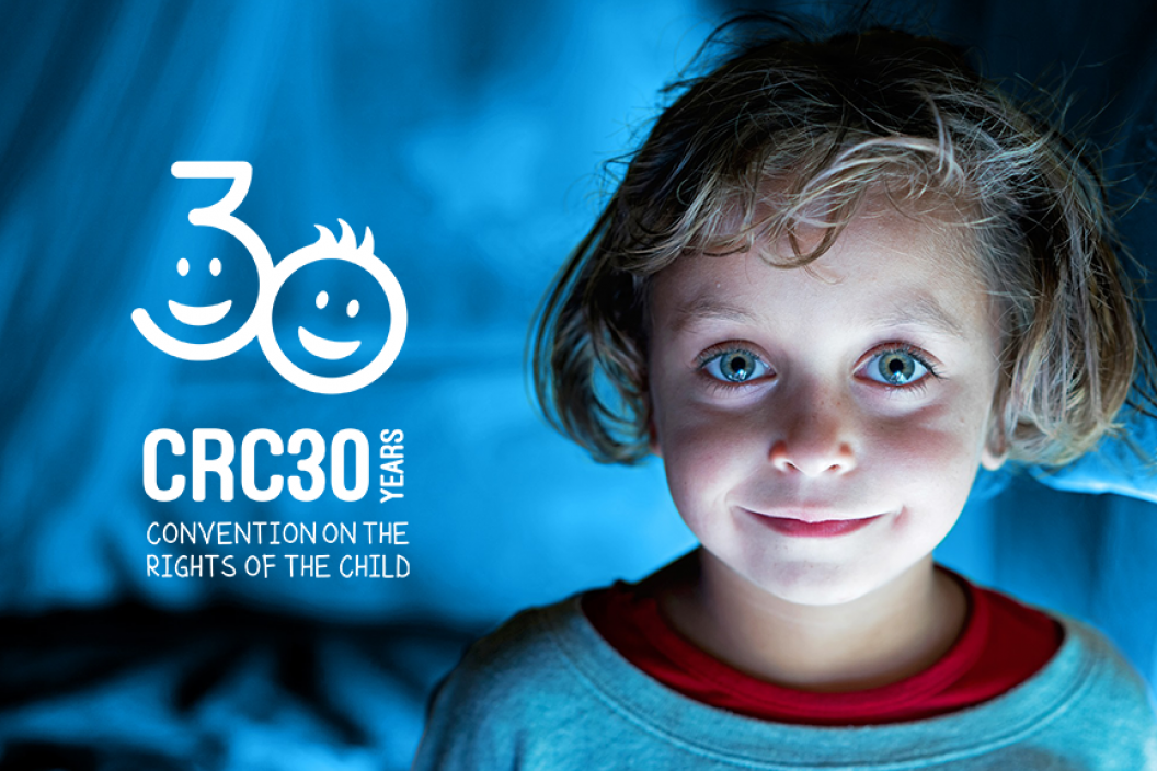 A homepage banner featuring a smiling girl with a layover logo of the Convention on the Rights of the child