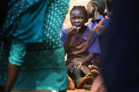 A student takes her lunch at the Wau A Girls Primary School in Wau