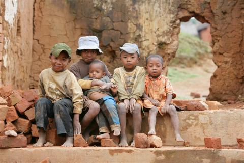 Children sitting by the street in the village of Ambohijafy 15 kms south of Antananarivo, the capital.