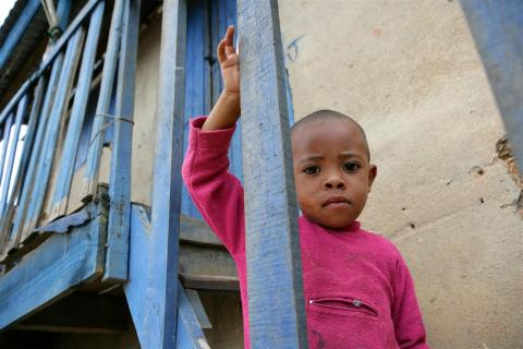 A child stands on stairs leading to a UNICEF child-friendly space in Antananarivo, the capital.