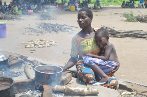 Three-year-old Lincy cries as her mother prepares a meal at Chagambatuka Primary School, their temporary shelter in Chikwawa