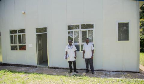 Mallious with a fellow health worker outside the Ebola treatment unit at Karonga district hospital