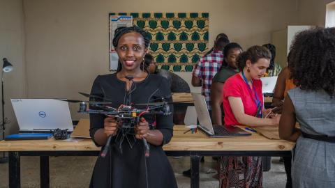 Anne with a drone under construction at the African Data and Drone Academy