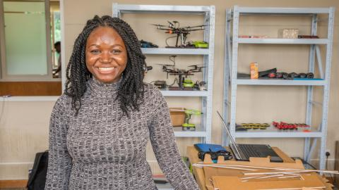 Hafsatu at the African Data and Drone Academy (ADDA) laboratory with a drone controller