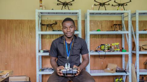 Fred at the African Data and Drone Academy (ADDA) laboratory with a drone controller