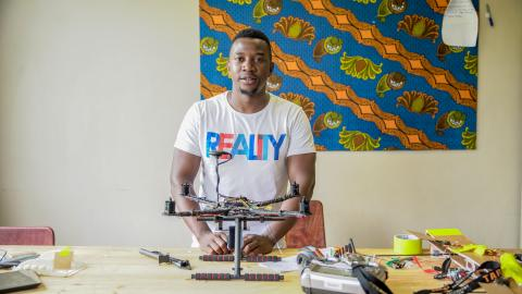 Hope at the African Data and Drone Academy (ADDA) laboratory working on  a drone