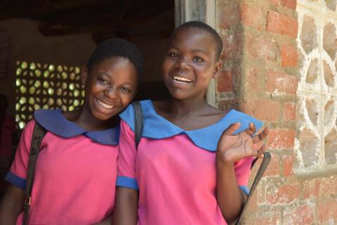 Ruth (r) and Christina outside a classroom at school in Bangula, Nsanje