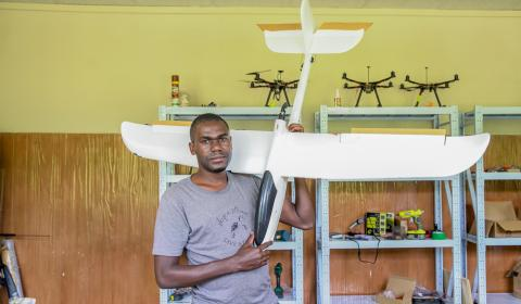 Emmanuel holding a drone at the African Data and Drone Academy