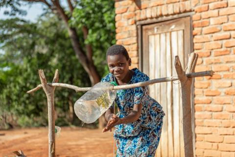 A girl washing her hands with soap at her village in Nkhatabay