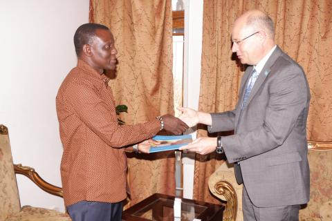 Rudolf Schwenk presenting his papers to the Minister of Foreign Affairs, Hon. Kasaila