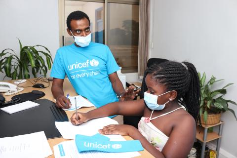 UNICEF Chief of Health Tedla Damte, interacting with one of the children's takeover particpants on World Children's Day