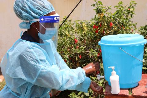 A health worker washes her hands at Mchinji Emergency Treatment Unit
