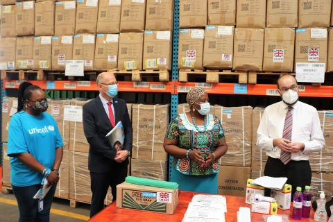 The UK Minister for Africa, James Duddridge (c) visits the UNICEF Warehouse to see COVID-19 supplies procured with support from UK Aid. He is accompanied by the Minister of Health Hon. Kandodo, UNICEF Country Representative Rudolf Schwenk and UNICEF Supply Specialist Diana Chikuwi