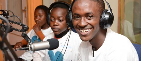 Youth Out Loud journalist Frank Shaka from Mangochi Secondary School  participates in the Day of the African Child celebrations at Capital FM radio station in Blantyre