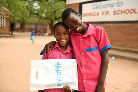 Standard five pupils, Prince Batala (Left) and his friend Edward Guta are captured at Bangula Full Primary School in Nsanje District, Malawi, December 01,2020. UNICEF/2020/THOKOCHIKONDI