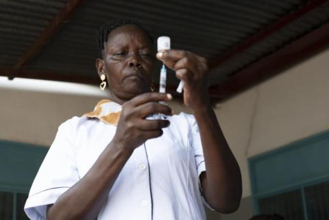 A South Sudances, nurse Lillian Nimaya, 45, fills a syringe with a vaccine