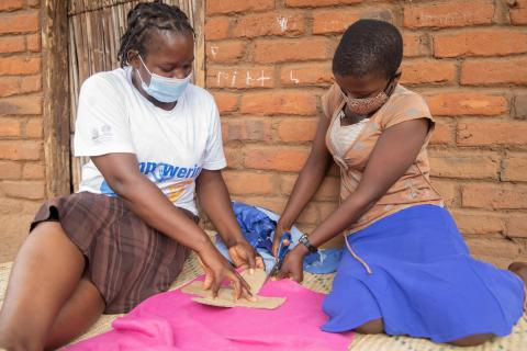 Rosemary and her teacher making reusable menstrual pads