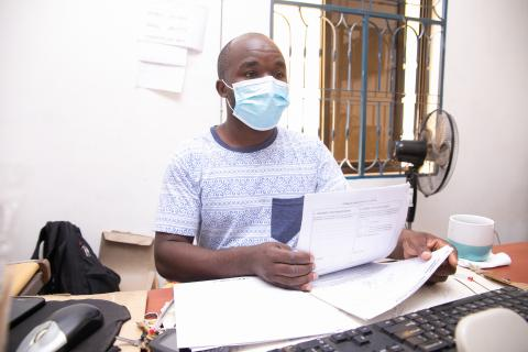 Richard Mbuto back in his office at Songwe border following his recovery from COVID-19
