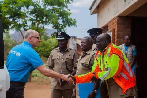 UNICEF Country Representative Rudolf Schwenk interacting with Police in rural Zomba
