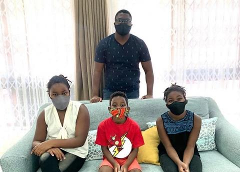 Rodrick Mhango and his three children