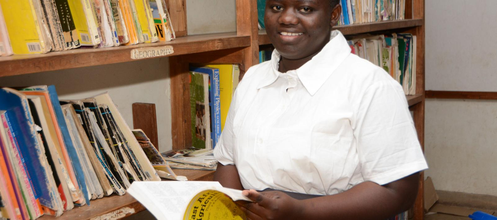 A UNICEF bursary recipient in the library at Ngabu Secondary School