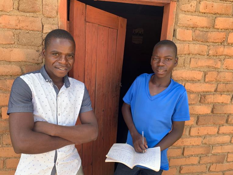 Phillip at home with his older brother. He motivates Phillip to work hard as he is the only one who finished secondary school in their family.
