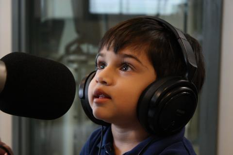 Child with big earphones