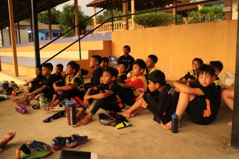 Teenage boys sitting in sport complex