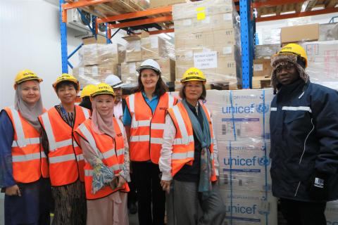 WHO, MOH, and UNICEF at warehouse receiving polio vaccine supplies
