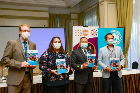 UNFPA, UNICEF and DM Analytics reps pose with new report