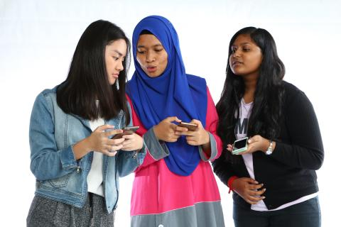 Three girls on their phone