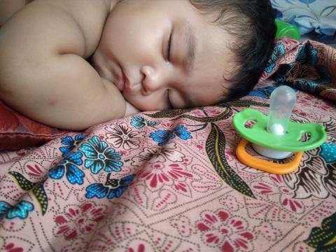 Baby sleeping on blanket