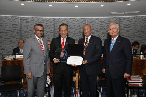 Malaysia's Minister of Health, Dr Dzulkefly Ahmad receiving the certificate of elimination at the WHO Regional Committee for the Western Pacific