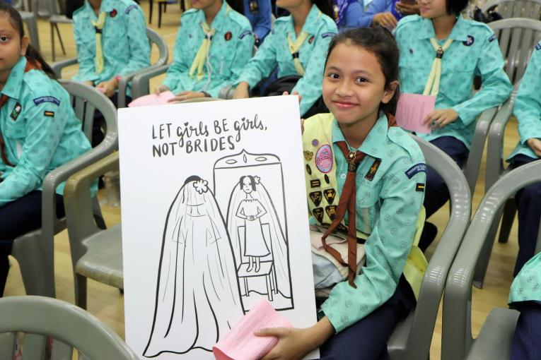 Girl guide with drawing of child bride