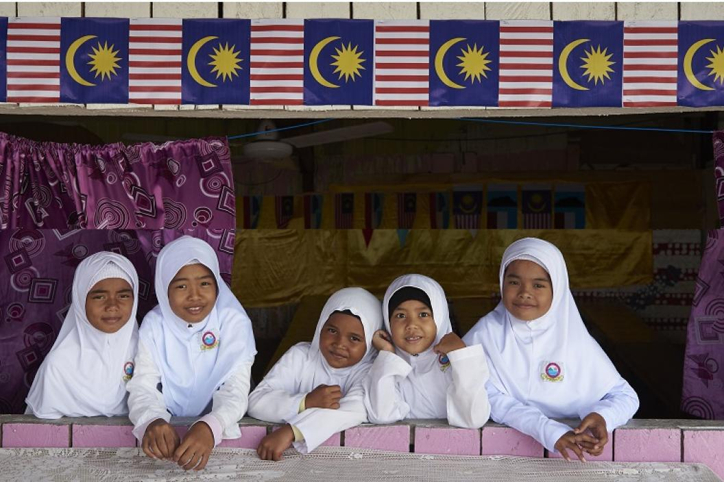 children in school with Malaysian flag