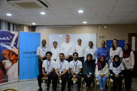 apprentices and staff of unicef and manta air stand for a photo