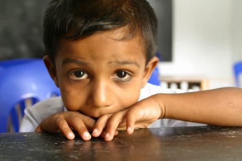 A child at his desk at school.