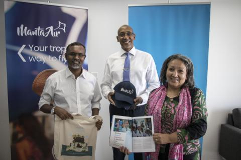 Manta Air CEO, UNICEF Maldives Representative and UNICEF Regional Director holding advocacy materials for a photo