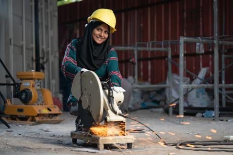Neeshan shows her skills at using an construction equipment