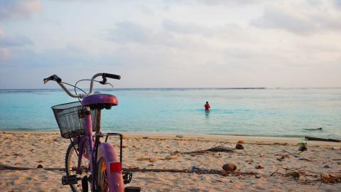 A bicycle on a beach.