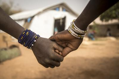 Fatoumata* and Aichata*, both 12, hold hands at a newly created displacement site in Sevare.