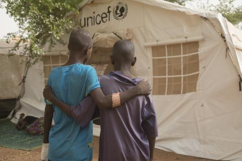 Two injured children outside a UNICEF tent at the regional hospital in Mopti. A total of 31 children sustained injuries, mostly gunshot wounds, burns and fractures, when the village of Ogossagou-Peulh in Bankass, Mopti region, was attacked on the night of 23 March 2019.