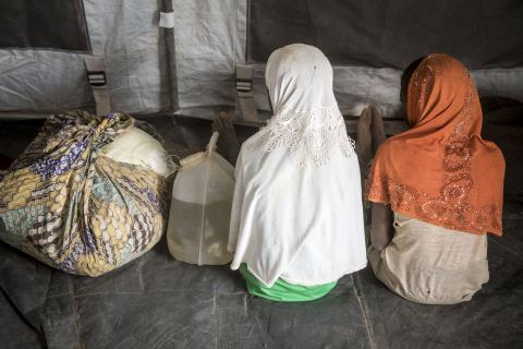 Fatoumata* and Aichata*, both 12, inside a UNICEF tent at a newly created displacement site in Sevare.
