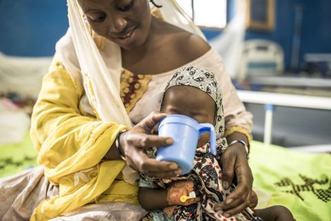 "Aminata Cissé, 20, gives therapeutic milk to her daughter Maya Ag Oumar, 12 months, at the regional hospital in Timbuktu. Maya is suffering from severe acute malnutrition with medical complications (malaria and anemia). ""I was scared of losing her,"" her mother says. ""She was sleeping all the time and she wasn't playing. She didn't even have the energy to cry. I'm very happy with the treatment here."" Today, Maya is recovering thanks to therapeutic milk and medication supplied by UNICEF"