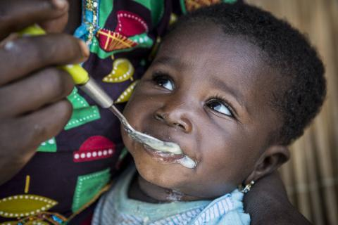 Chatou Dembele 6 months old, eats porridge enriched with micronutrient powder. Despite being the breadbasket of the country, the Sikasso region has the highest rate of stunting in Mali. One out of three children is stunted. Sikasso, August 2019.