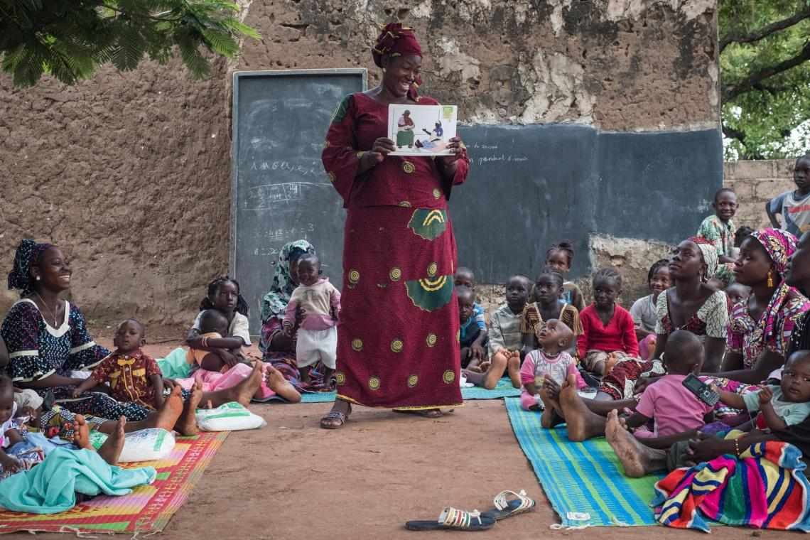 In Yorosso, role model mothers like Bassan Koita (centre) spread knowledge of key health, nutrition and hygiene practices to other mothers and caretakers in sessions using simple words and with the support of illustrative pictures.